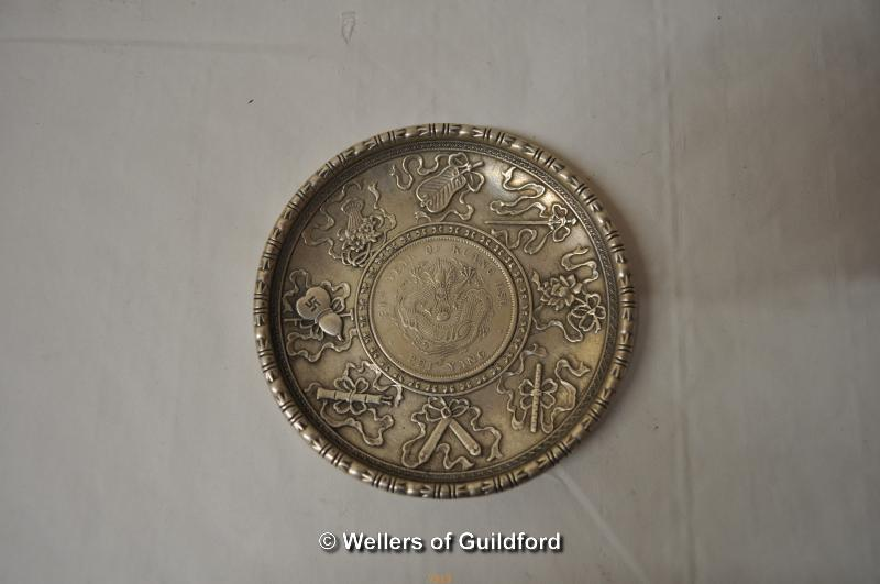Lot 7313 - A Chinese white metal dish with coin inset to centre, 9.75cm.