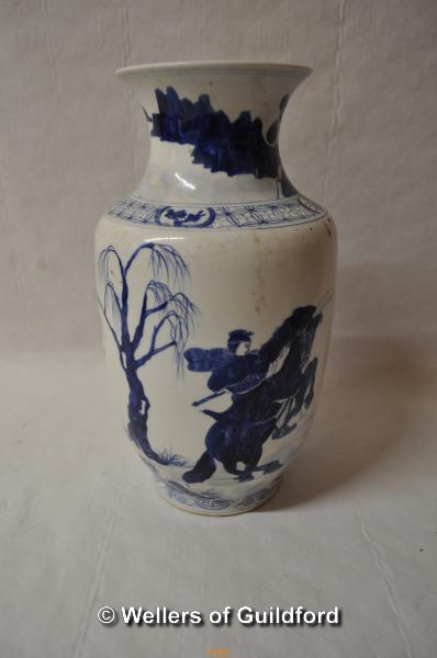 Lot 7483 - A Chinese blue and white baluster vase decorated with warriors on horseback, 29.5cm.
