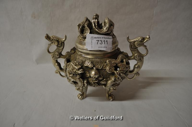 Lot 7311 - A Chinese white metal censor with dragon handle to lid and twin dragon handles, 15cm.