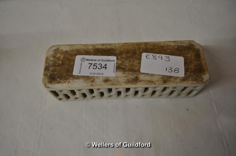 Lot 7534 - A Chinese blue and white rectangular paperweight with pierced decoration, 15cm long.
