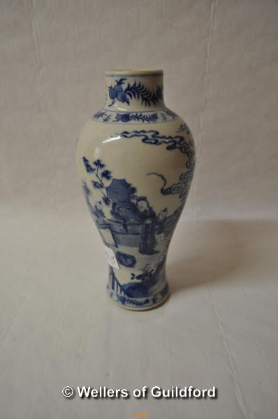 Lot 7479 - A Chinese blue and white baluster vase decorated with figures in a garden, two blue rings to base,