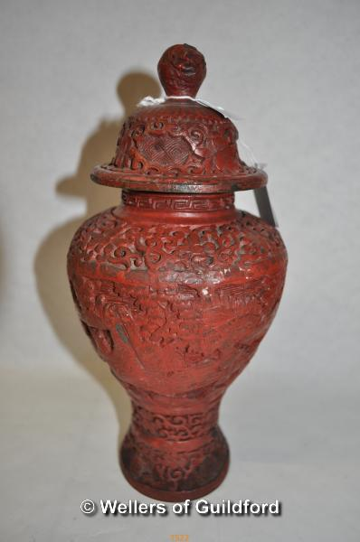 Lot 7522 - A Chinese cinnabar lacquer vase and cover, 25cm.
