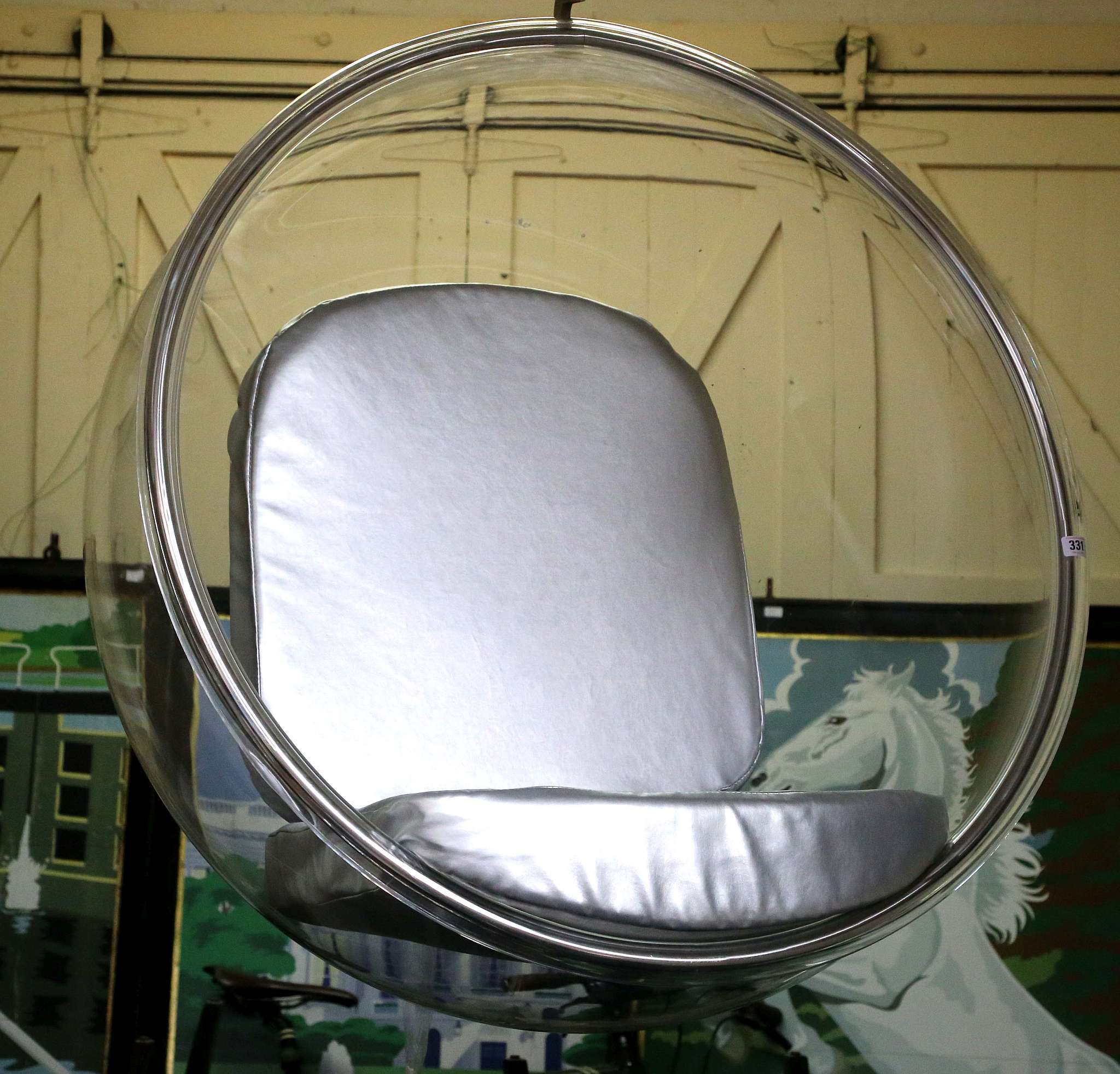 An Eero Sarrinen style hanging ball chair perspex with silver