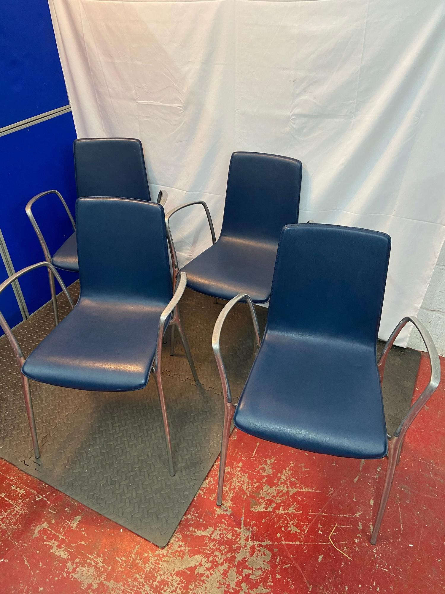 A Set of four Spanish designer Akaba dining chairs designed by Jorge Pensi. Blue leather material