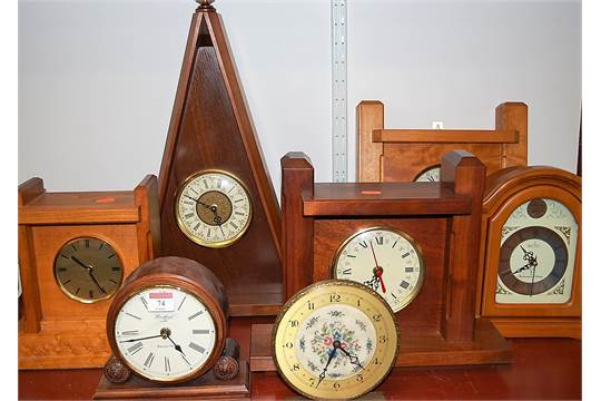 A reproduction beech cased Acctim Tempus Fugit mantel clock
