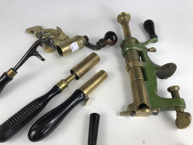 Lot 49 - A quantity of antique shot gun tools including Bartram 12-bore cartridge trimmer, capping tool and