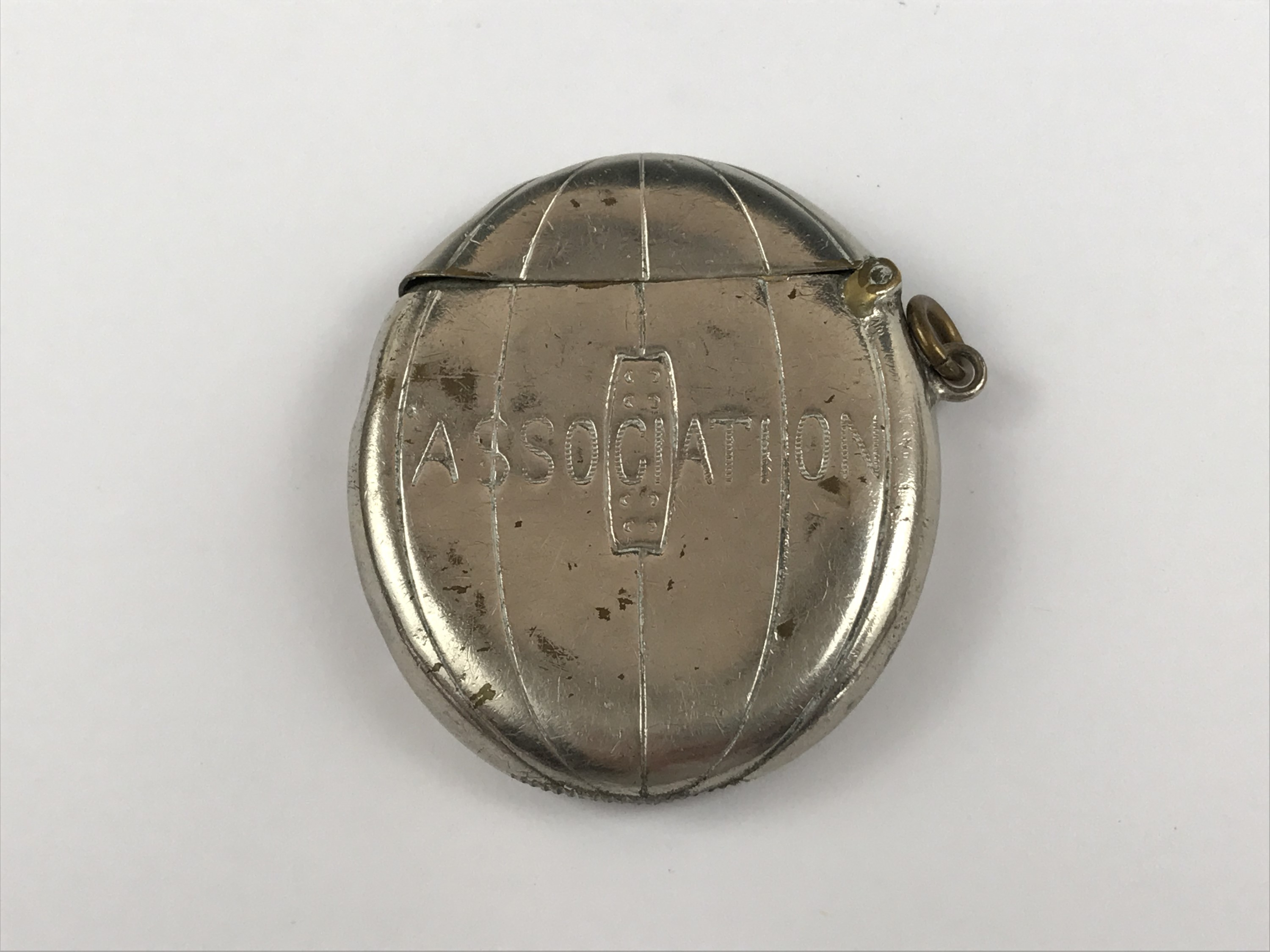 Lot 25 - A Victorian Football Association silver-plated vesta case modelled in the form of a laced leather