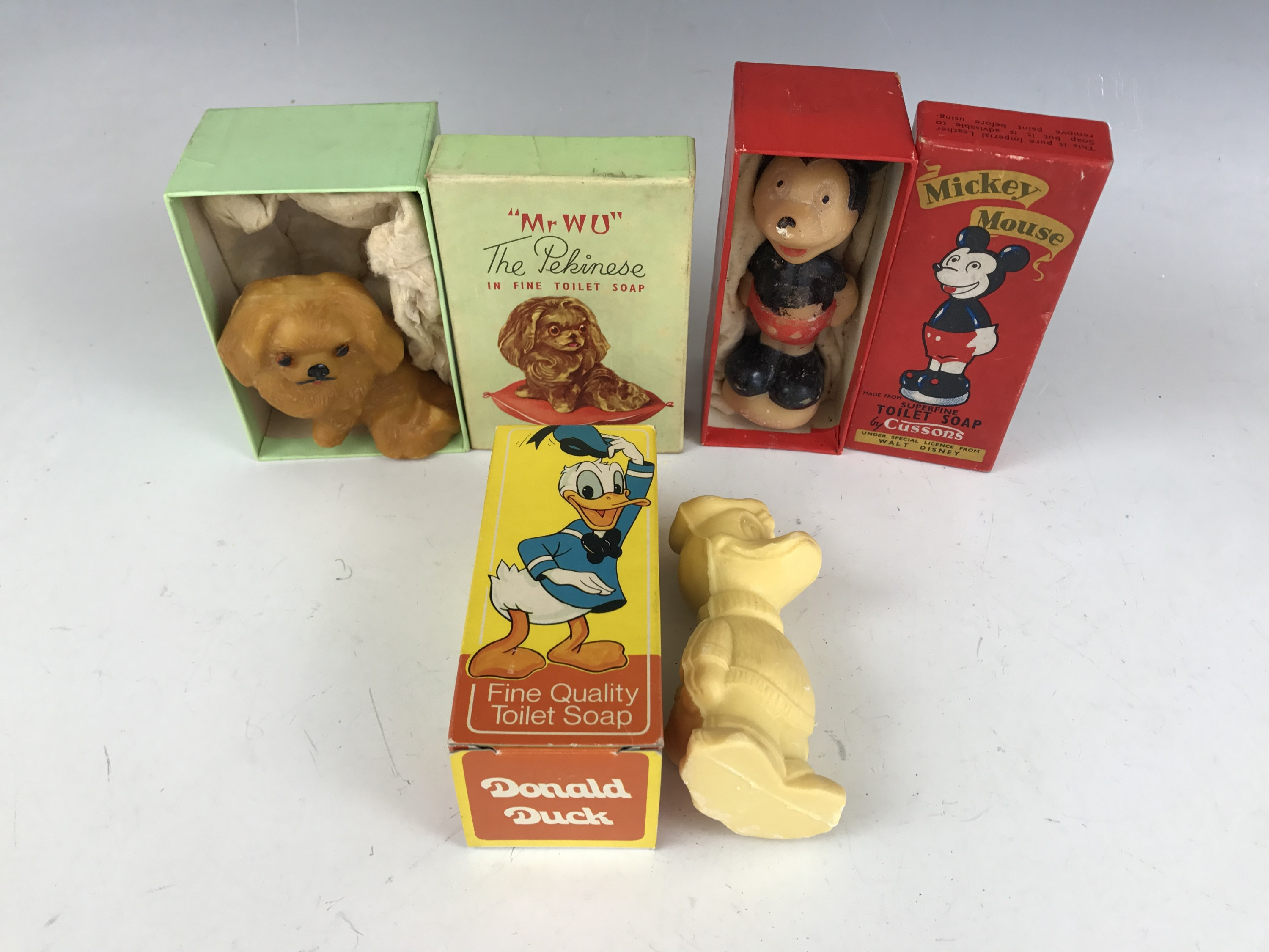 """Lot 39 - Cussons vintage boxed novelty soaps, comprising Mickey Mouse and """"Mr Wu"""" The Pekinese, together with"""