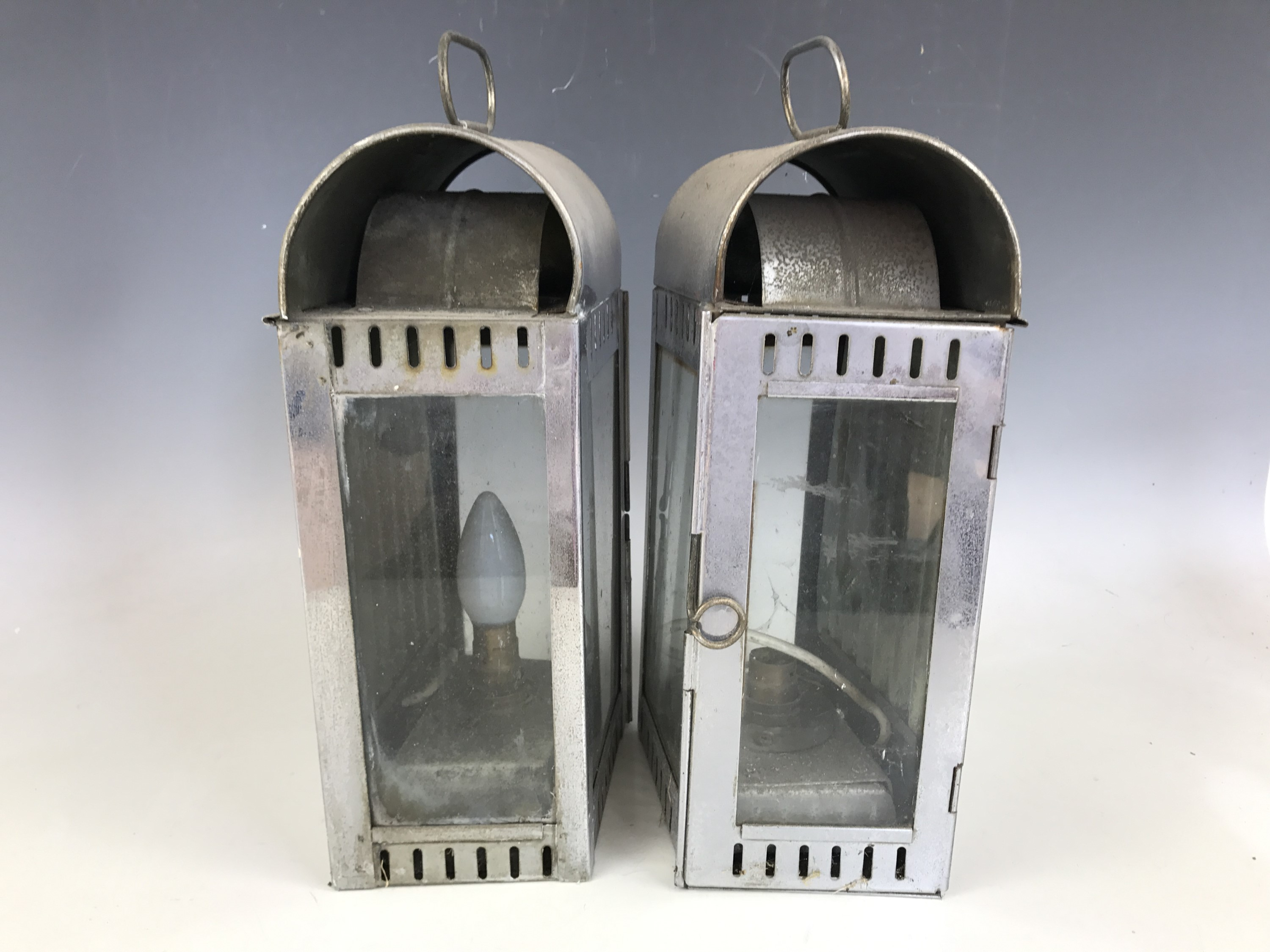 Lot 29 - A pair of 19th Century marine oil lanterns (converted to electricity), 38 cm