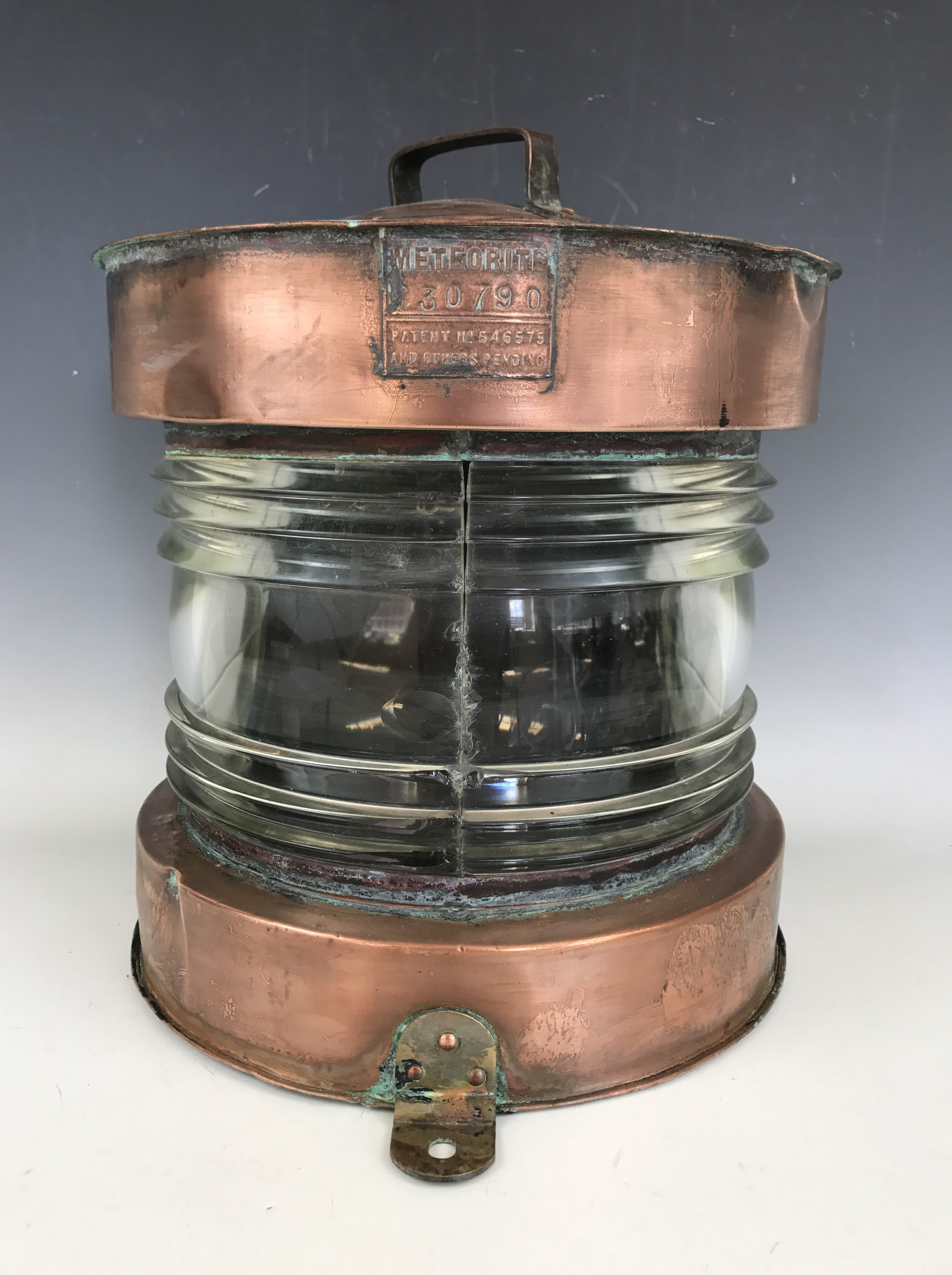 Lot 20 - A ship's large copper Meteorite ship's masthead lantern, having a bisected clear fresnel lens, 35