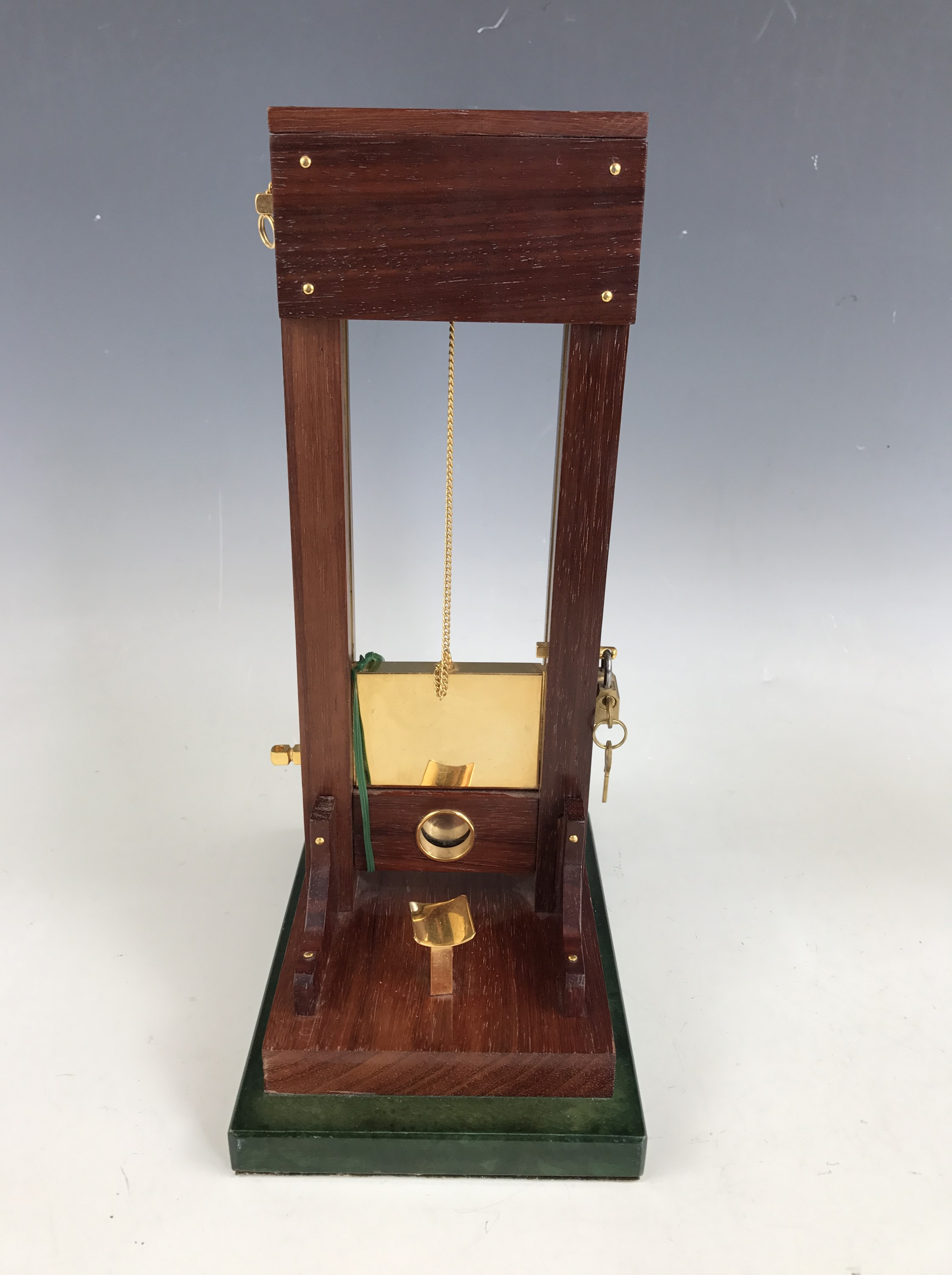 Lot 27 - A table cigar cutter modelled as a guillotine, late 20th Century, 34 cm