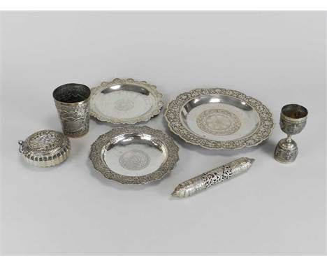 A 19th century Indian white metal tumbler, together with a white metal pierced cylindrical lidded container, three white meta