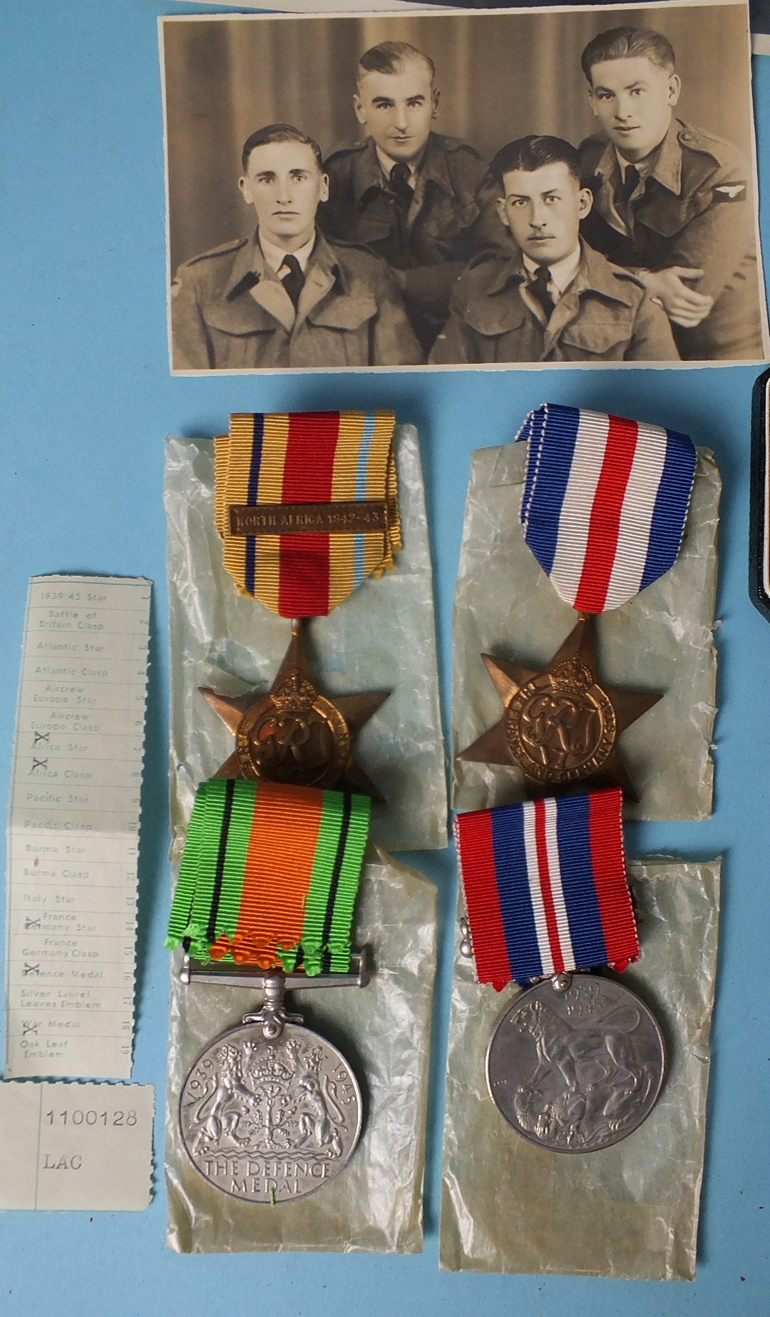 Lot 574 - A WWII group of four medals awarded to Eric Biddle RAF: Africa Star with North Africa 1942-43 clasp,