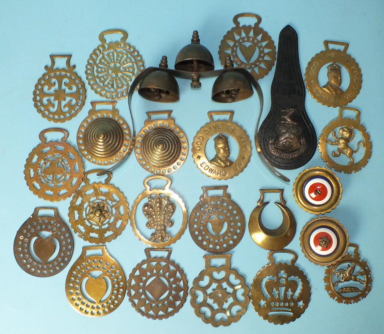 Lot 688 - Horse brasses, a brass terret with bells and a collection of horse brasses, including two bull eyes,
