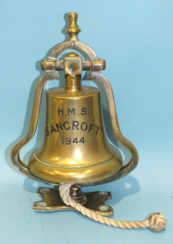 A bracket-mounted bronze ship's bell, 'HMS Sancroft 1944', on shaped bracket, 30cm high, bell