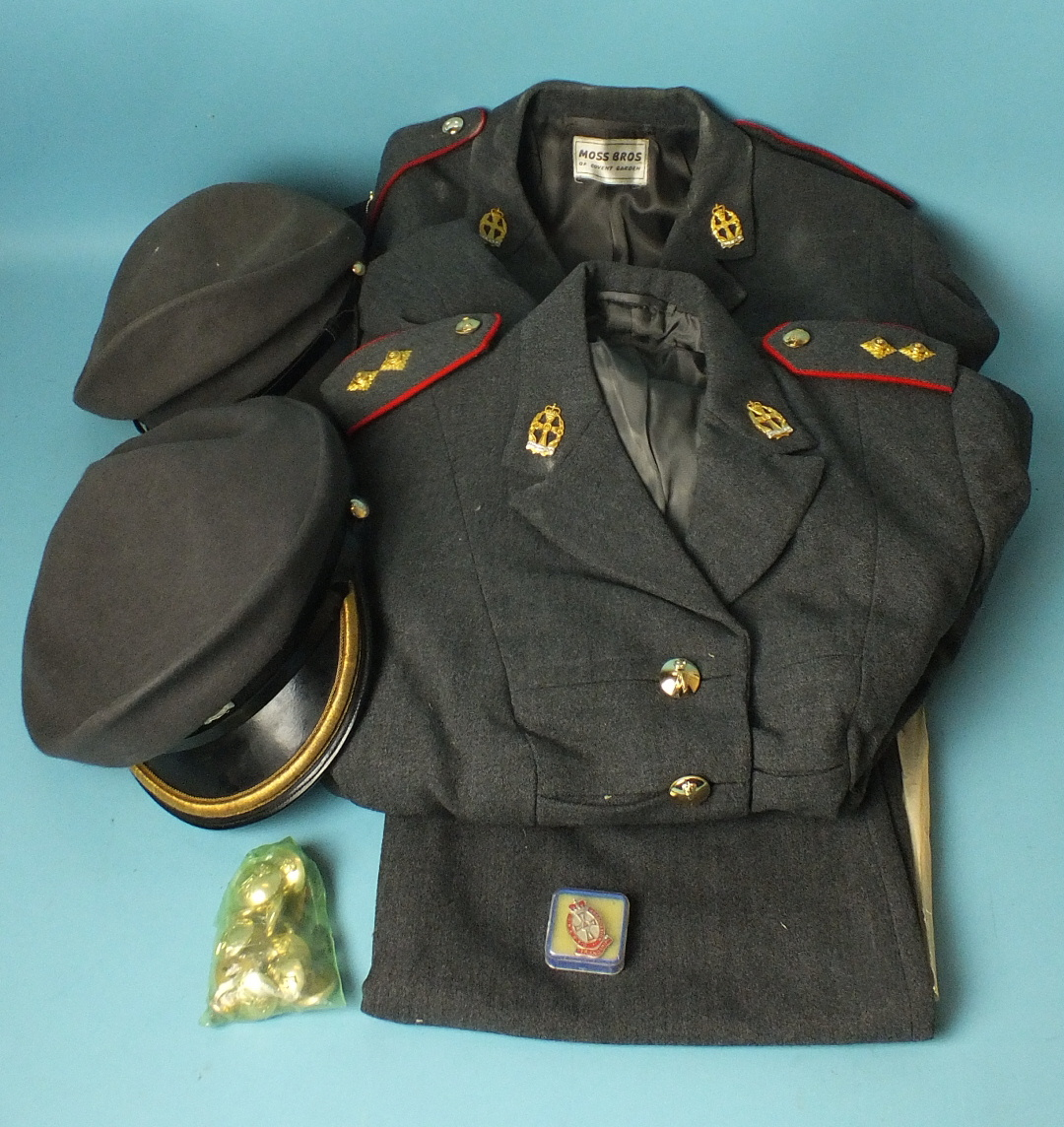 Lot 597 - Queen Alexandra Royal Army Nursing Corps: two uniform jackets, one skirt, two caps, a quantity of