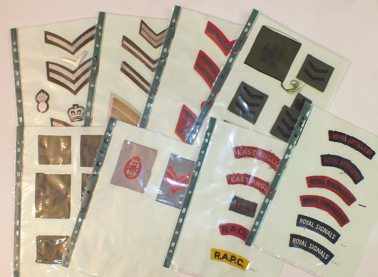 Lot 589 - A collection of 144 mainly cloth badges, including division signs, rank badges, etc.
