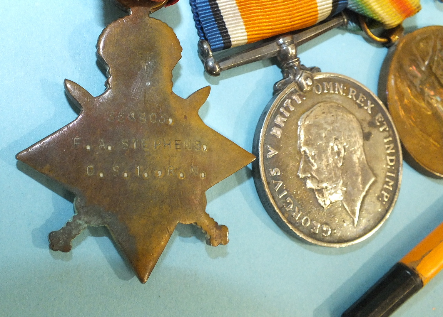 Lot 573 - A group of four WWI medals awarded to: 364903 F A Stephens O.C.I. RN, including 1914-15 Star, 1914-