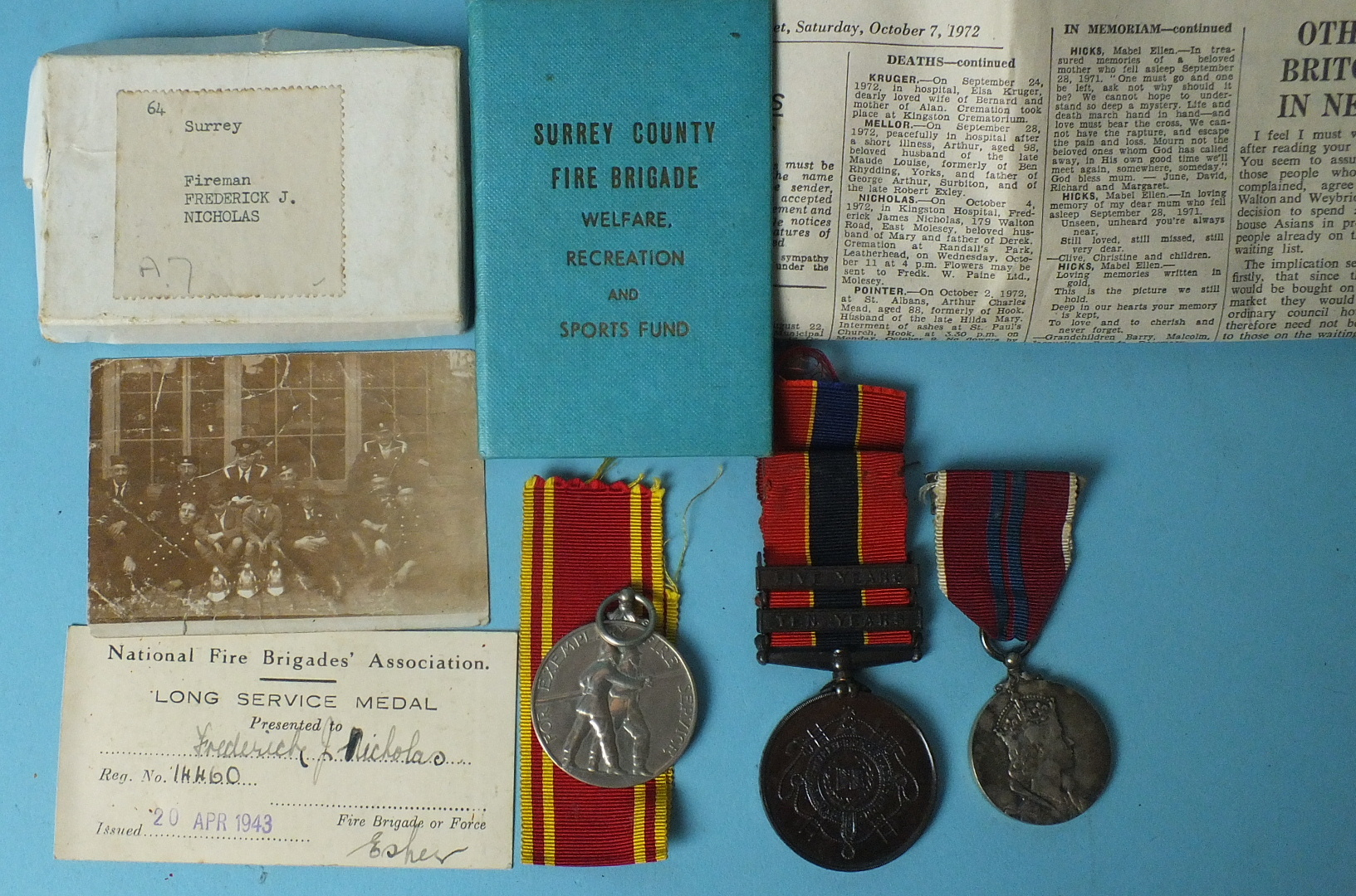 Lot 577 - An Exemplary Fire Service Medal awarded to Fireman Frederick J Nicholas, with ribbons, envelope
