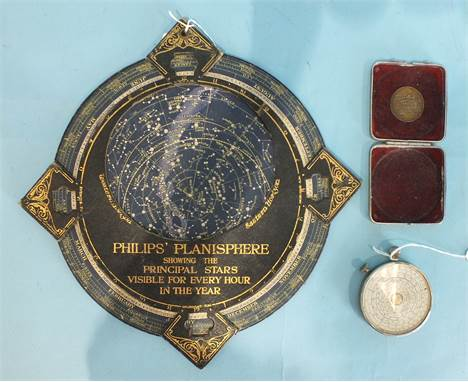 A Philips Planisphere showing the principal stars visible for every hour in the year, on card backing, George Philip & Son Lt