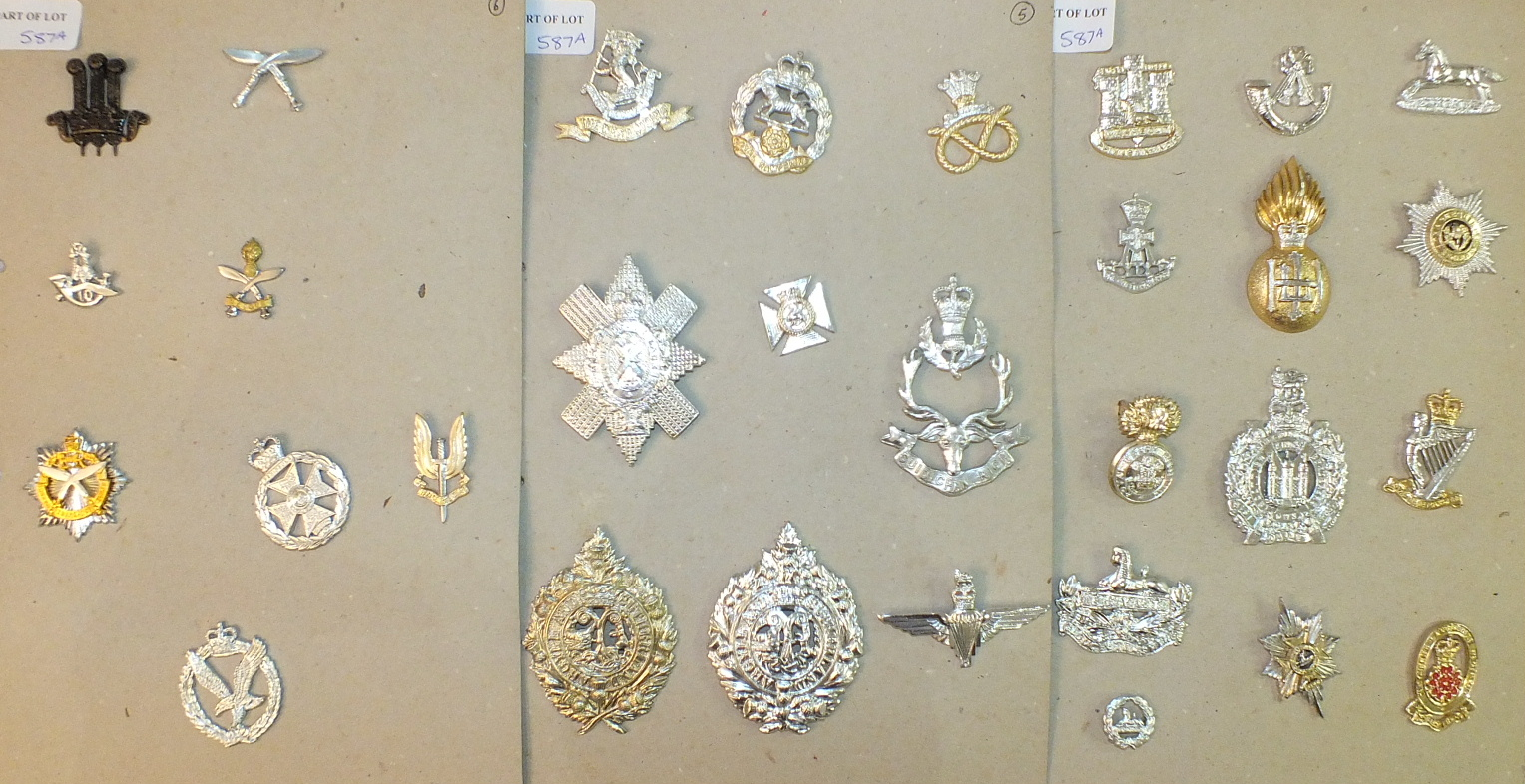 Lot 587A - A large collection of Staybright British Army cap badges, including Royal Army Chaplain badges,