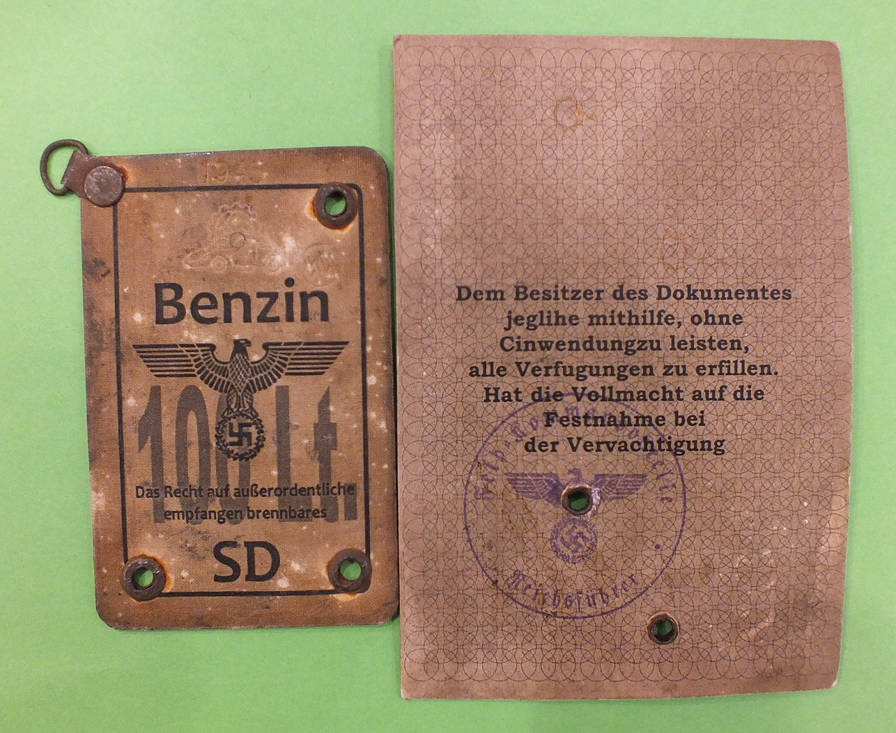 "Lot 595 - A WWII German SS members identity card, a German petrol 100Lt ration pass stamped ""1945"", a WWII"