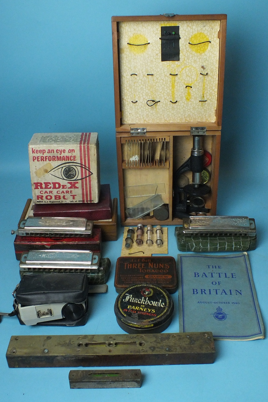 Lot 687 - Three Hohner Chromonicas, cased, a brass-faced Atkin & Sons level, 30.5cm, a small wood level,