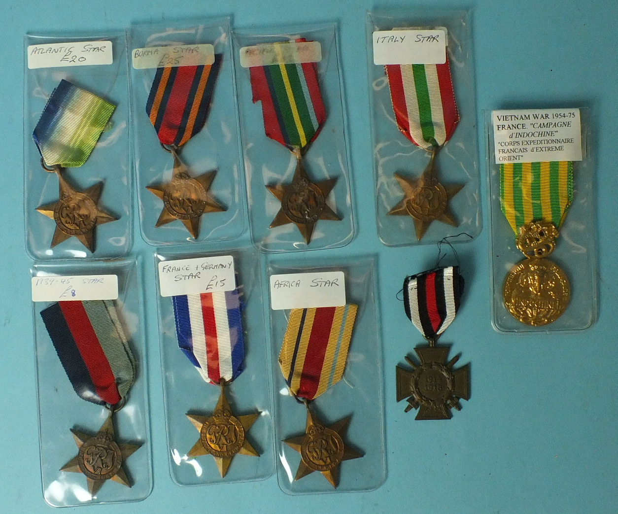 Lot 576 - Seven WWII Stars: 1939-45, Africa, Atlantic, Burma, France & Germany, Italy & Pacific, a German