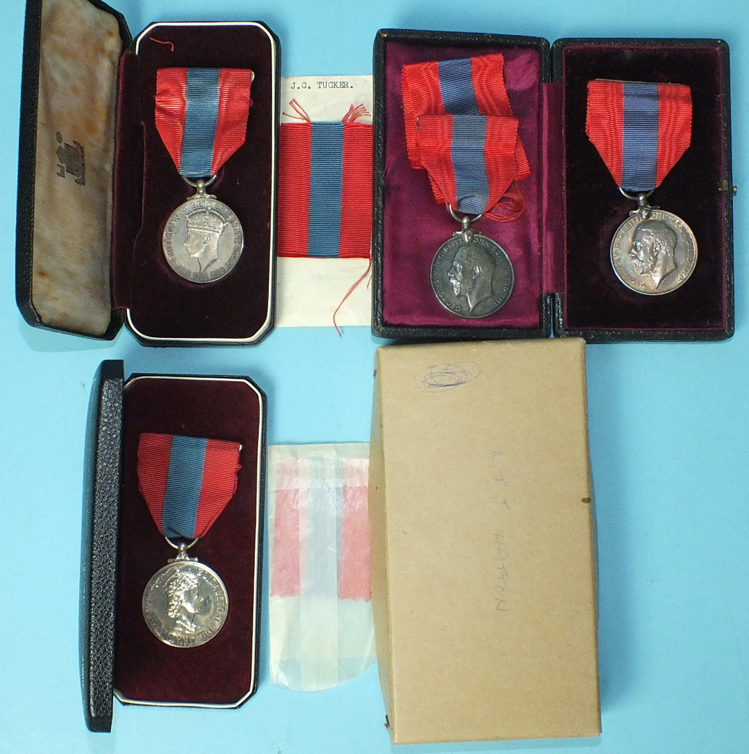 Lot 582 - Three boxed Imperial Service Medals to John Rendle, LTJ Hatton and James Charles Tucker and another,