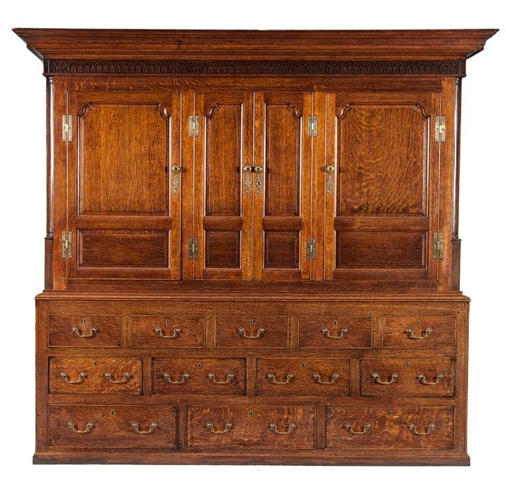 Lot 21 - A large George III oak housekeeper's cupboard, circa 1780