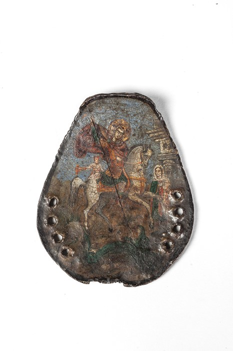 Lot 58 - A painted iron badge, 18th / 19th century