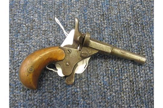 Pistol: A Belgian  22 cal blank firing single shot pistol