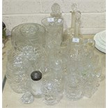 A collection of glassware, including decanters, jugs, drinking glasses, etc.
