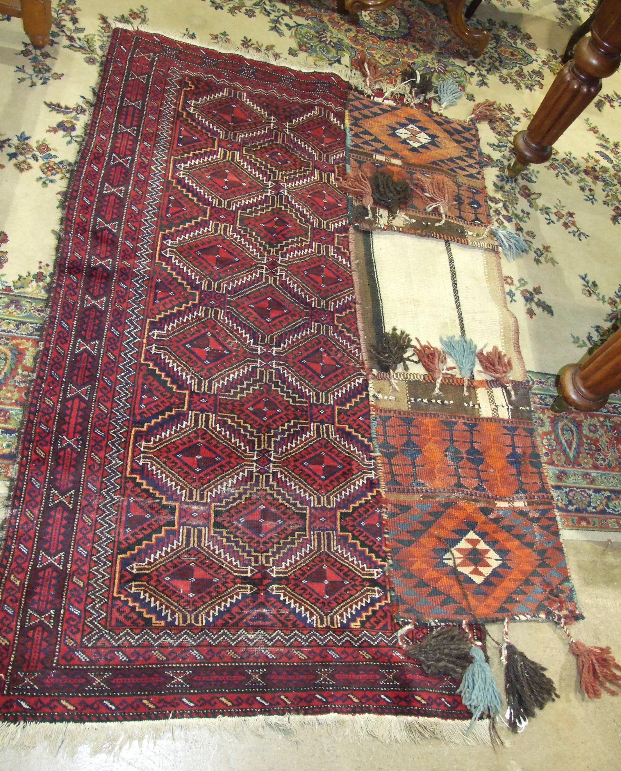 Lot 23 - An Eastern rug, 181 x 98cm and a saddle bag rug, (2).