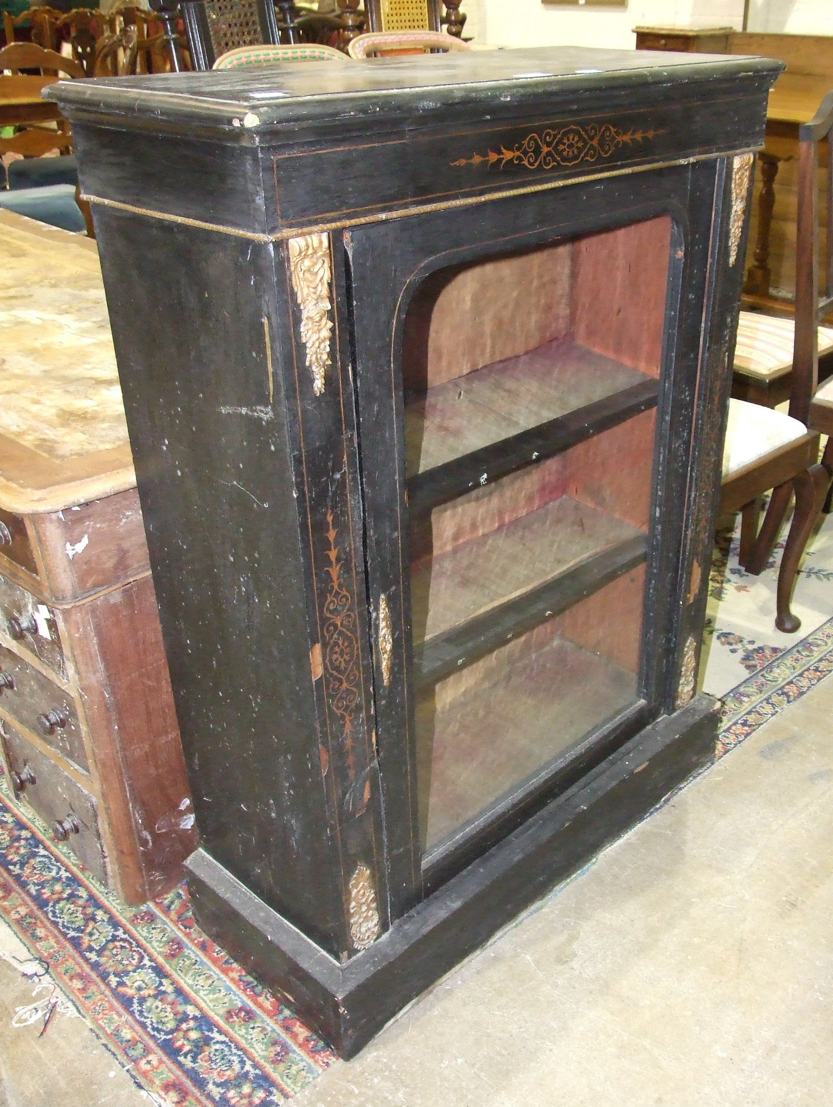 Lot 38 - A 19th century ebonised display cabinet, 76cm wide and a 19th century pedestal writing desk, both in