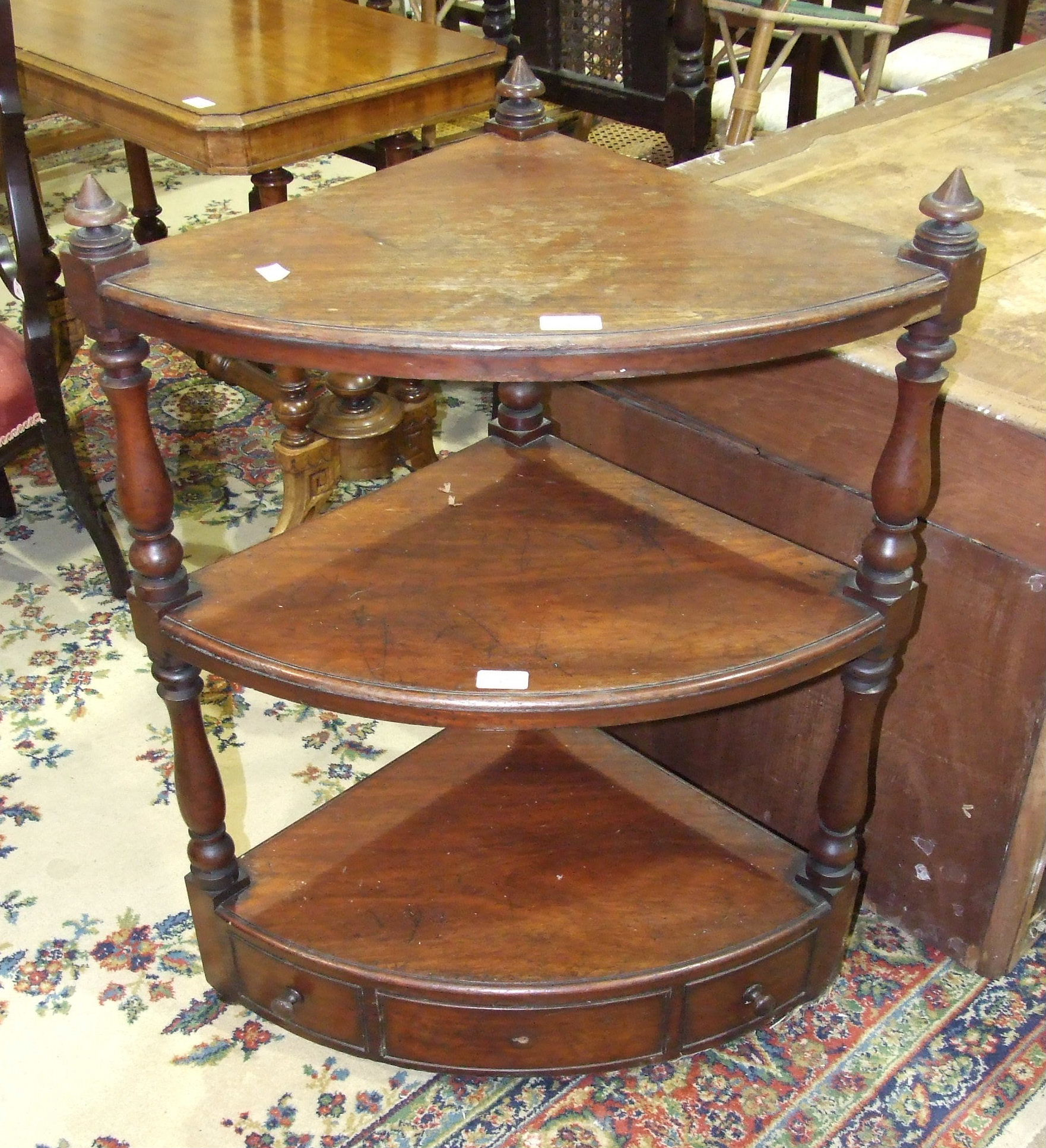 Lot 37 - A 19th century mahogany three-tier corner whatnot, 64cm wide, 85cm high.