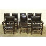 A set of six walnut 19th century dining chairs with leather-upholstered and studded backs and seats,
