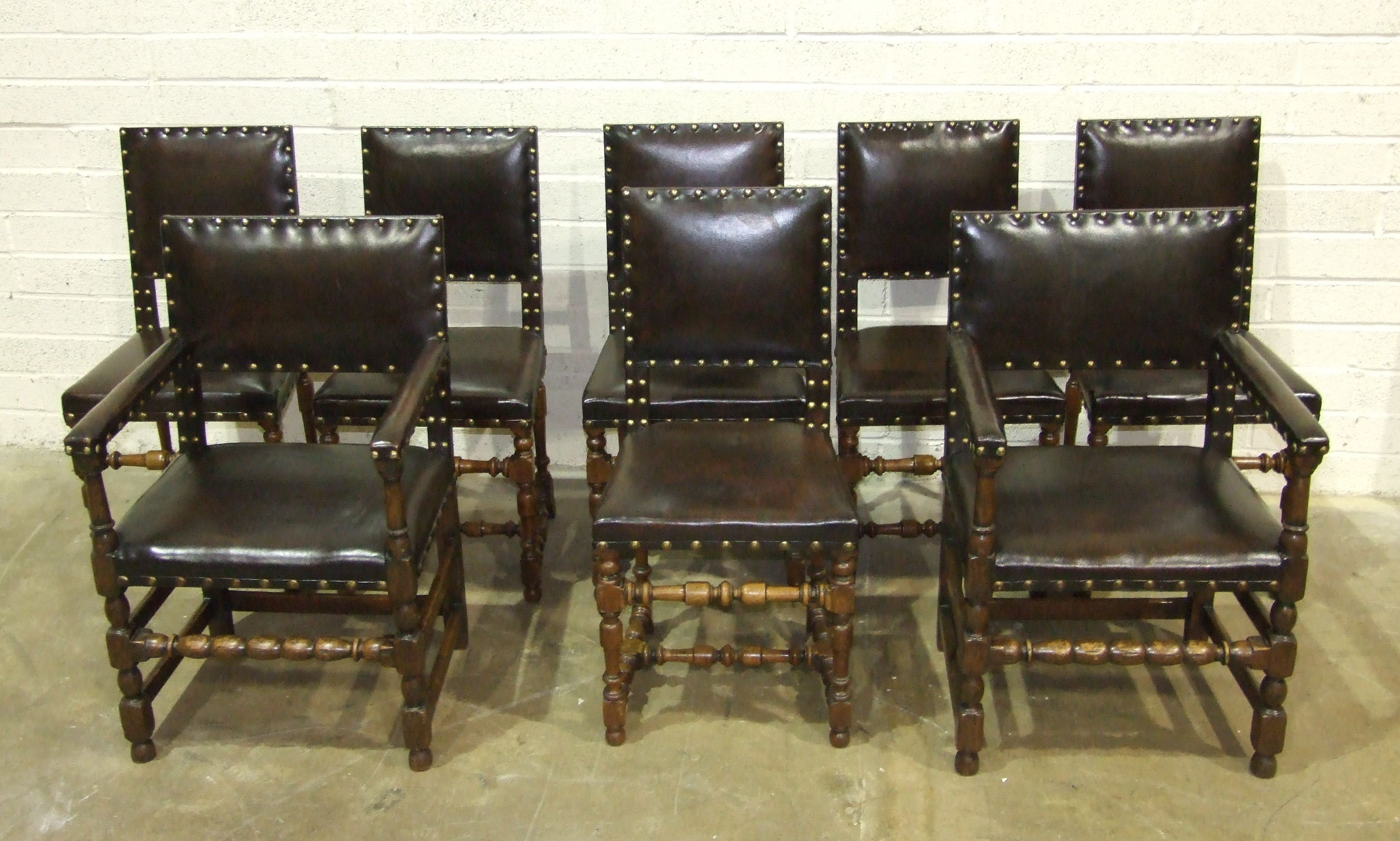 Lot 32 - A set of six walnut 19th century dining chairs with leather-upholstered and studded backs and seats,