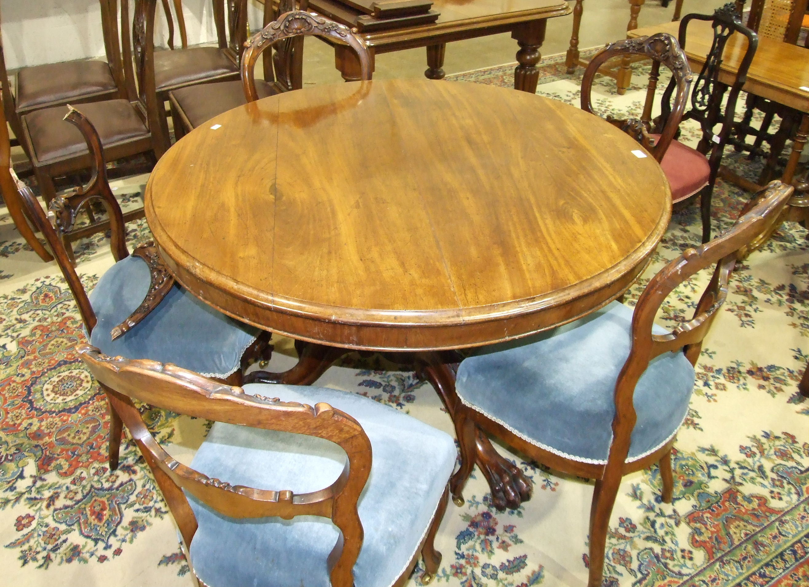 Lot 42 - A Victorian mahogany circular breakfast table with moulded border, on turned column.
