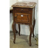 A French pot cabinet, with marble top above a small drawer and cupboard door opening to reveal a