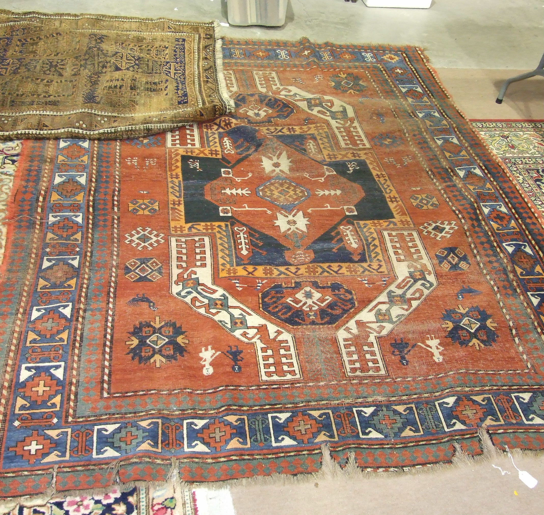Lot 22 - An Eastern rug decorated with figures, animals and geometric shapes, 245 x 192cm and one other