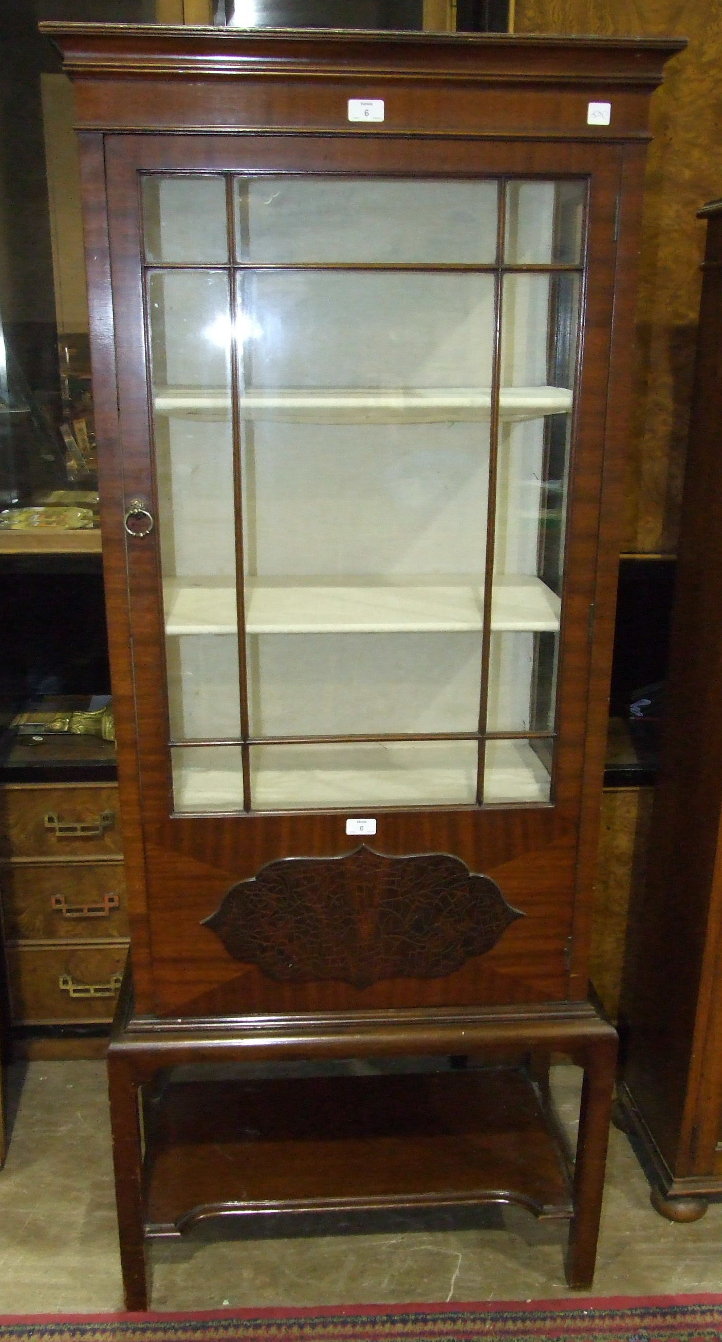 Lot 6 - An early-20th century display cabinet, the rectangular top above two glazed sides and door, on