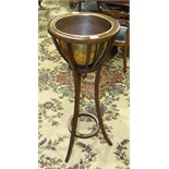 An early-20th century mahogany jardinière stand, the flared basket-pattern top with moulded rim
