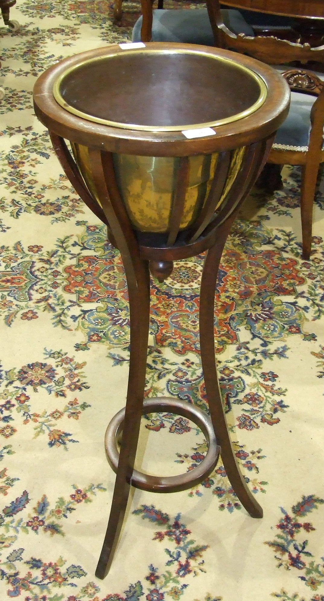 Lot 26 - An early-20th century mahogany jardinière stand, the flared basket-pattern top with moulded rim