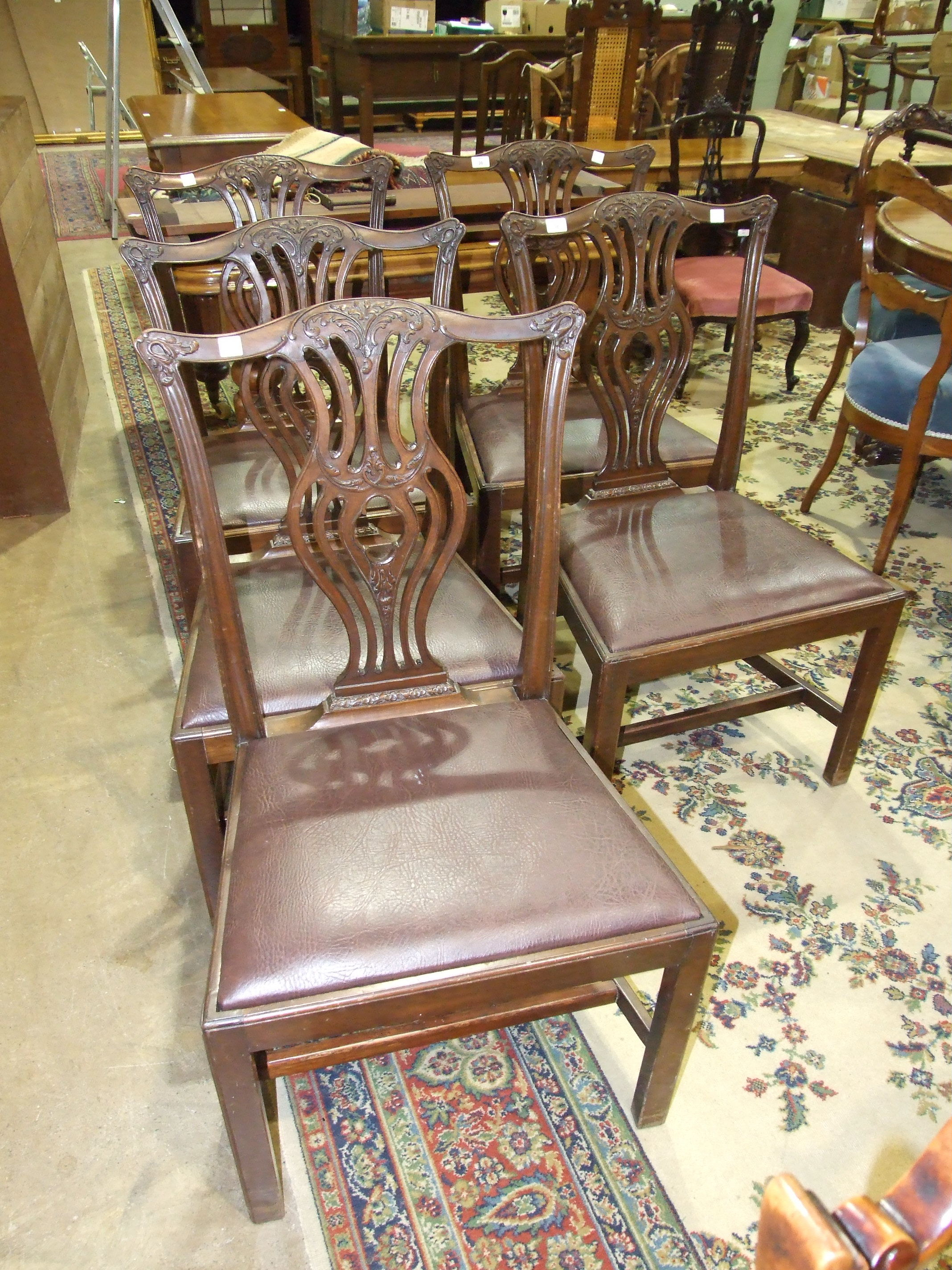 Lot 36 - Five mahogany Chippendale-style dining chairs, (5).