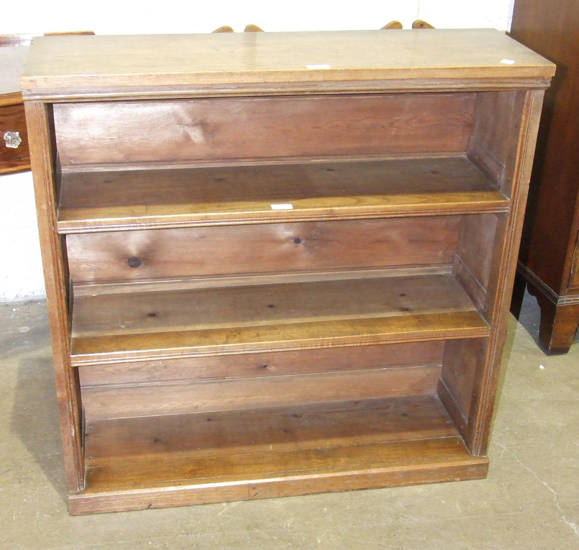 Lot 2 - A walnut freestanding open bookcase, 91cm wide, 93cm high, 30cm deep.