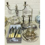 A plated two-branch candelabrum, a plated entrée dish and cover, plated cutlery and other plated