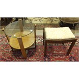 A 1950's/60's oak circular occasional table with plate glass top, the supports joined by an