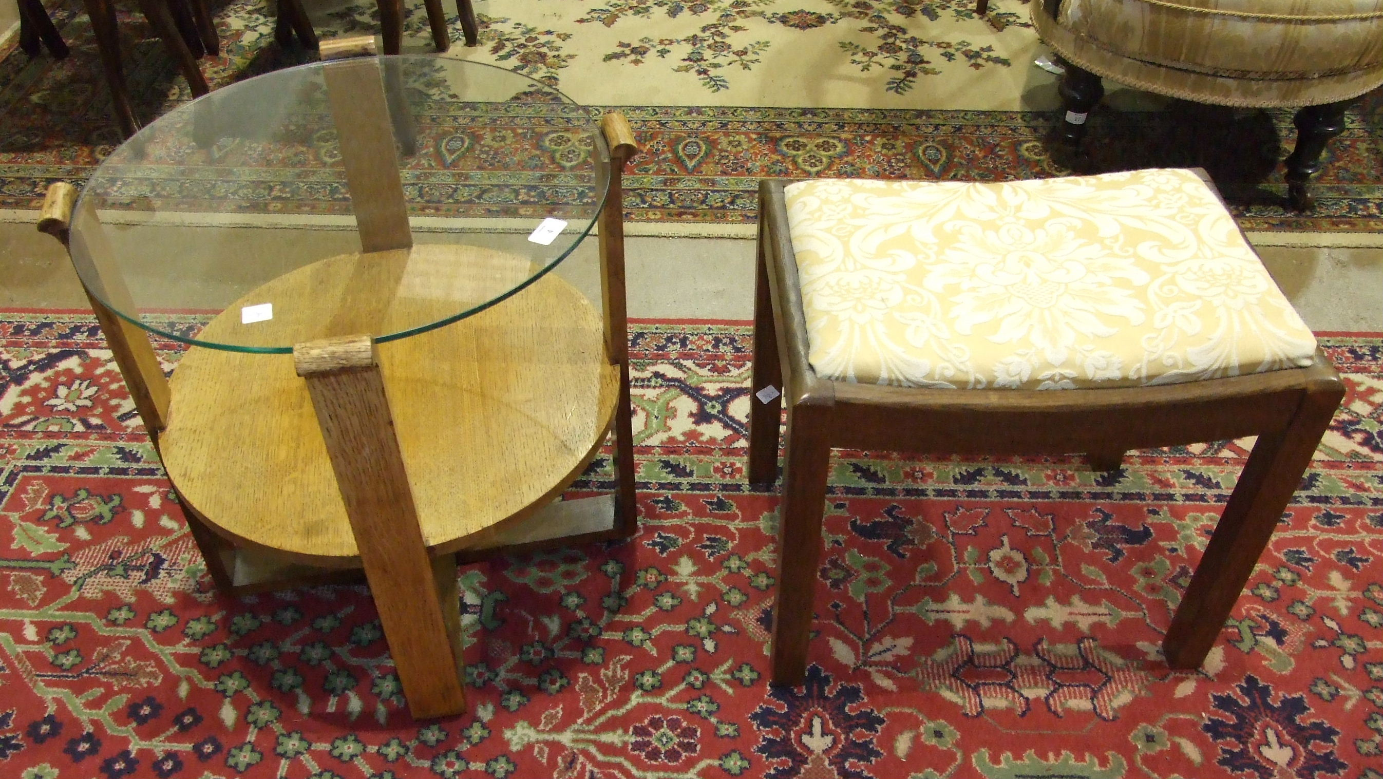 Lot 4 - A 1950's/60's oak circular occasional table with plate glass top, the supports joined by an