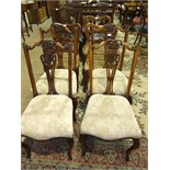 Three Victorian walnut dining chairs, each with shaped back, carved centre bar, drop-in seats, on